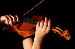 Musician playing violin. Isolated on black Royalty Free Stock Photos