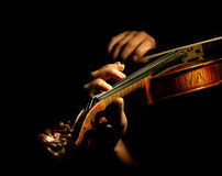 Musician playing violin. Isolated on black Royalty Free Stock Images