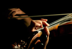 Musician playing violin. Isolated on black Stock Photography