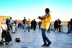 Musician playing the violin in Cordoba stock photo