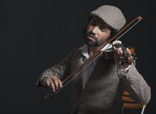 Musician playing a violin Royalty Free Stock Image