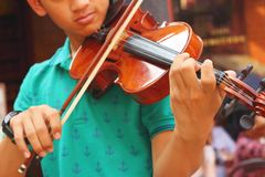Musician playing violin melodically at the park Stock Images