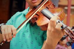 Musician playing violin melodically at the park Stock Image