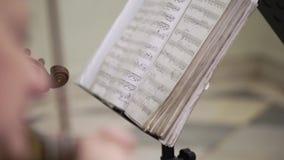 Musician playing violin. Closeup indoors stock video