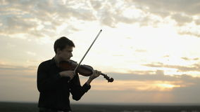 Musician playing violin on the roof, classic music. stock video