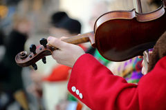 Musician playing violin on the street. Close up photo. Stock Photos
