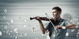 Musician playing violin Stock Photo