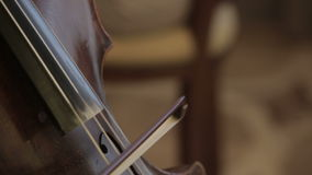 Musician playing violoncello stock video footage