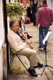 A musician plays Royalty Free Stock Photos