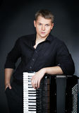 Musician plays the accordion Royalty Free Stock Photos