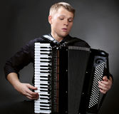 Musician plays the accordion Royalty Free Stock Photo