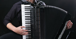 Musician plays the accordion royalty free stock photography