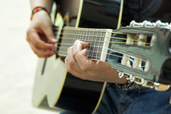 The musician plays an acoustic guitar. Royalty Free Stock Photos