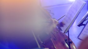 The musician plays the cello at a concert stock video footage