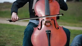Musician plays on the cello stock video