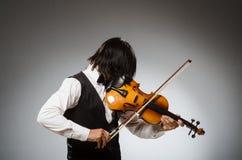 Musician plays cello  on white Stock Photos