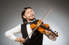 Musician plays cello  on the white Royalty Free Stock Image