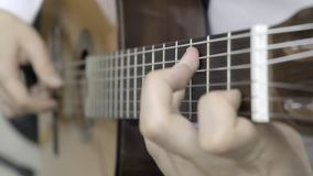 The musician plays the classical guitar. Slow motion stock video