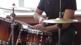 The musician plays the drums stock footage