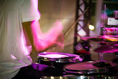Musician plays drums in a rock band Royalty Free Stock Image