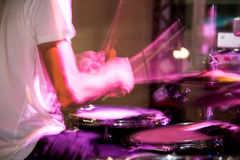 Musician plays drums in a rock band.  Stock Images