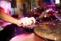 Musician plays drums in a rock band.  Royalty Free Stock Images