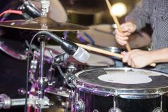Musician plays drums in a rock band.  Royalty Free Stock Image
