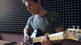 Musician plays on electro guitar in the Studio. stock video footage