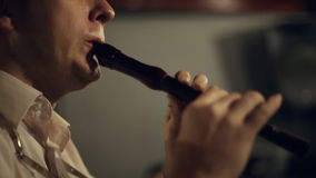Musician plays the flute stock footage
