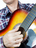 Musician plays guitar Royalty Free Stock Image