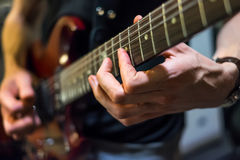 Musician plays a guitar Royalty Free Stock Photography