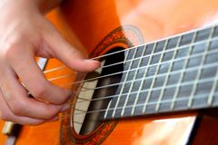 Musician plays guitar fingers stock photography