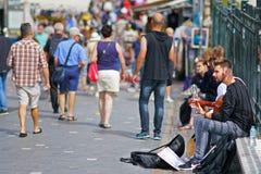 musician plays guitar on the street in Monastiraki stock photos