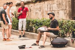 Musician plays hang drum in the street Stock Image