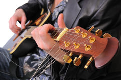 Musician plays his acoustic guitar. This is a close up of a musician playing his acoustic guitar stock images
