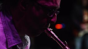Musician plays jazz in gig stock video footage