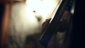 The musician plays jazz music on the cello. In the club stock footage