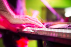 Musician plays keyboards in a rock band.  Royalty Free Stock Images