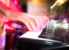 Musician plays keyboards in a rock band.  Stock Image