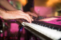 Musician plays keyboards in a rock band.  Royalty Free Stock Image