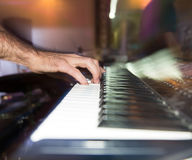 Musician plays keyboards in a rock band.  Stock Photos
