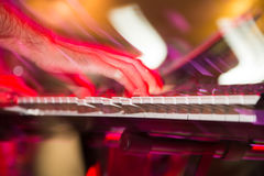 Musician plays keyboards in a rock band.  Stock Photo