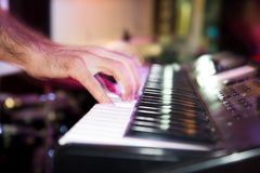 Musician plays keyboards in a rock band.  Royalty Free Stock Photography
