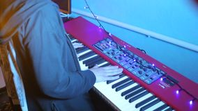 Musician plays the keys at rehearsal. Musician plays the keys at a rehearsal, rear view stock video footage