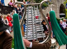 Musician plays a lyre at a parade in Garmisch-Partenkirchen, Garmisch-Partenkirchen, Germany - May 20. Musician plays a lyre at a parade in Garmisch Royalty Free Stock Photo