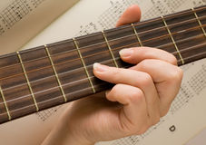Musician plays a musical instrument,guitarist. And a guitar Royalty Free Stock Images