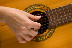 Musician plays a musical instrument,guitarist. And a guitar Stock Image