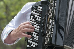 The musician plays an old accordion. In the street Stock Images