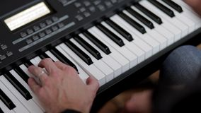 The musician plays the piano stock footage