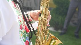 The musician plays the saxophone.  stock footage